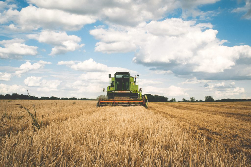 picture of tractor in a field as example of agriculture technology