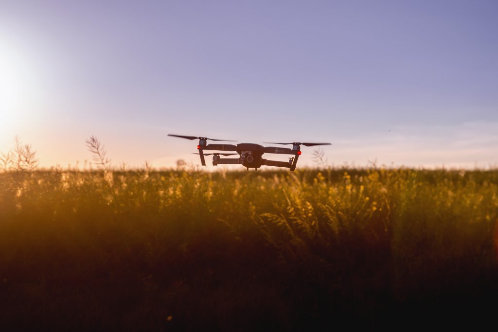 picture of dron flying over a field example of agriculture technology